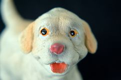 Gift plaster doggie. Front view. Shallow depth of field stock photo