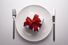 Gift on a plate Royalty Free Stock Image
