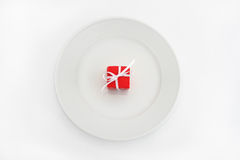 Gift on plate Royalty Free Stock Photography