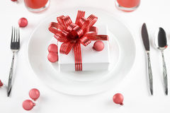 Gift on plate as table decorations Royalty Free Stock Photography