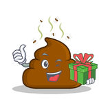 With gift Poop emoticon character cartoon Royalty Free Stock Photo