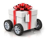Gift or present box with car wheels. Creative abstract Christmas or Xmas, New Year or birthday gift or present shipping, logistic and delivery business Stock Photos