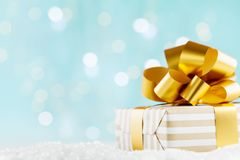 Gift or present box on magic bokeh background. Holiday composition for Christmas or New Year. stock image