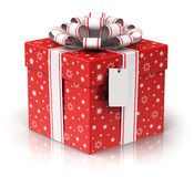 Gift or present box with ribbon bow and label tag Royalty Free Stock Photography