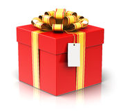 Gift or present box with ribbon bow and label tag Royalty Free Stock Image