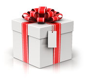 Gift or present box with ribbon bow and label tag Royalty Free Stock Photos
