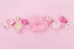 Gift or present box and spring flower on pink desk from above for wedding mockup or greeting card on womans day in flat lay stock images