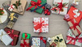 Gift present box in vertical top view wooden table full of christmas or birthday gifts presents.Xmas winter holiday. Season party social media card background royalty free stock images