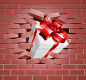 Gift Present Breaking Through Wall Stock Photo