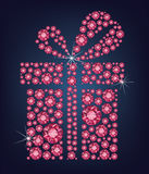 Gift present made up a lot of ruby diamonds on the black background Stock Photo