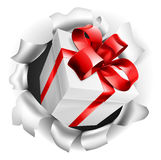 Gift Present Ripping Through Background Stock Photo