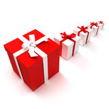 Gift presentation. 3D rendering of an alignment of presents of different sizes in red and white Royalty Free Stock Photos