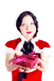 Gift of pretty brunette for Christmas Royalty Free Stock Photography