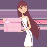 Gift product. Beauty promoter hoiding a gift Royalty Free Stock Images