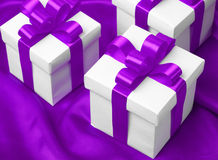 Gift on purple satin background Royalty Free Stock Photo