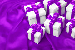 Gift on purple satin background Royalty Free Stock Images