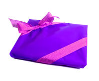 Gift in purple wrapping paper and pink ribbon Royalty Free Stock Photography