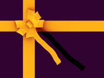 Gift in purple with yellow ribbon Stock Images