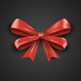 Gift realistic red bow and ribbons tilted on a black background. Beautiful vector illustration EPS 10 Royalty Free Stock Photos