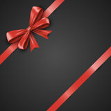 Gift realistic red bow and ribbons tilted on a black background. Beautiful vector illustration EPS 10. Gift realistic red bow and ribbons tilted on a black Royalty Free Stock Images