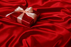 Gift on red Royalty Free Stock Images