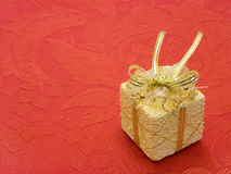 Gift on red background Royalty Free Stock Photography