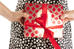 Gift with a red bow. Behind the back of the girl Stock Photo