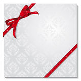 Gift with a red bow Royalty Free Stock Images