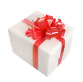 Gift with red bow. White gift with red bow isolated Royalty Free Stock Images