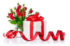 Gift with red bow and bouquet rose. On white background Stock Images