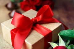 Gift with a red bow. Close-up. Valentines Day background, wedding day. Shallow DOF Royalty Free Stock Image