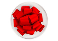 Gift and red bow. Isolated on white background Royalty Free Stock Photography