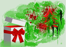 Gift with red bow and tree Royalty Free Stock Images
