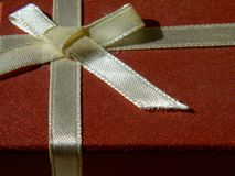 Gift red box with a beige bow. Surprise gift royalty free stock images