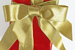 Gift red box with gold ribbon and bow.  Royalty Free Stock Images