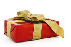 Gift red box with gold ribbon and bow isolated.  Stock Images