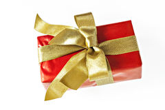 Gift red box with gold ribbon and bow isolated.  Royalty Free Stock Photos