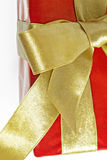 Gift red box with gold ribbon and bow isolated.  Royalty Free Stock Photography