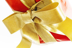 Gift red box with gold ribbon and bow isolated.  Royalty Free Stock Images