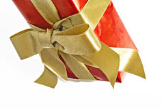 Gift red box with gold ribbon and bow isolated.  Stock Image