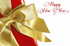 Gift red box with gold ribbon and text isolated.  Royalty Free Stock Photos