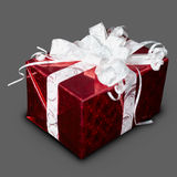 Gift in red box with a ribbon Royalty Free Stock Image
