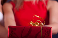 Gift. Red giftbox in woman's hand Stock Photo