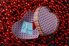Gift in red heart new year Stock Photos