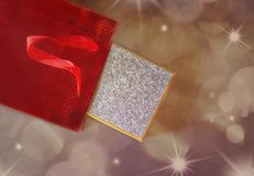 Gift in red paper bag on holiday background. Celebration and holiday shopping concept Stock Image