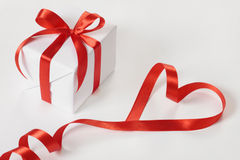 Gift and red ribbon. On white background Stock Image