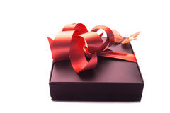 Gift with red ribbon. Gift red ribbon with a white background Royalty Free Stock Photography