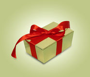 Gift with red ribbon Stock Images
