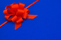 Gift red ribbon. Gift red ribbon on blue background Stock Images