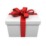 Gift with red ribbon. On white Royalty Free Stock Photos